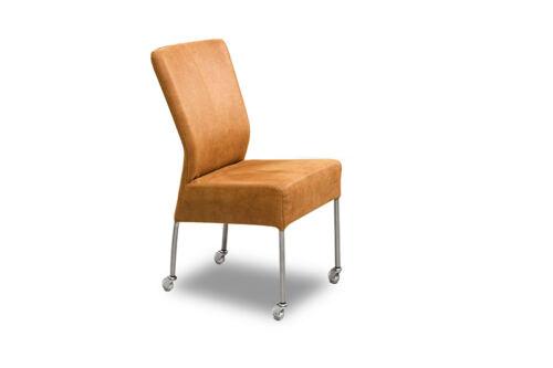 Eetkamer stoel Wiske van onze leverancier Mobitec. Comfortabele eetkamer stoel op wieltjes en leverbaar in verschillende stoffen en kleuren. Een nieuwe eetkamer stoel nodig? Kom inspiratie opdoen in de Woonwinkel & Meubelmakerij van Sessink Wonen te Gendt, gelegen tussen Arnhem en Nijmegen.